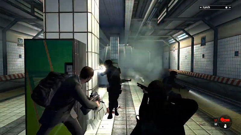 Kane menembaki musuh dari belakang tembok
